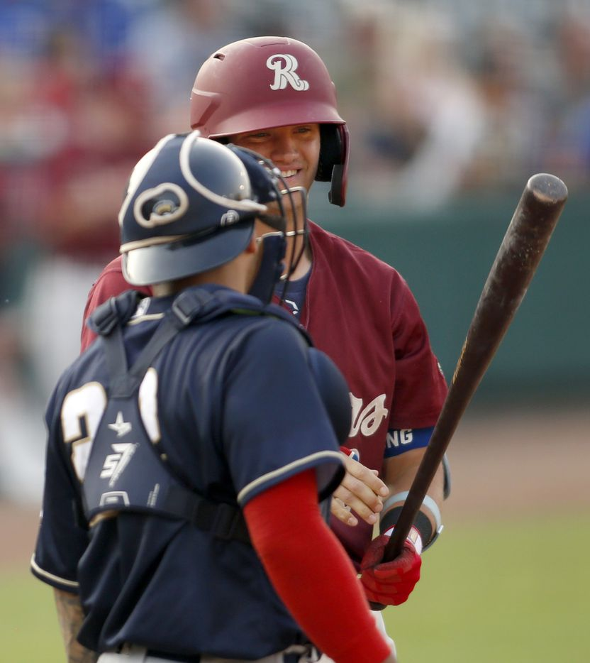 Frisco RoughRiders 3rd baseman Josh Jung (18) shares a light moment with San Antonio catcher Juan Fernandez (22) as he comes to bat during the bottom of the 2nd inning of play. The two teams played their minor league baseball game at Riders Field in Frisco on June 22, 2021 (Steve Hamm/ Special Contributor)