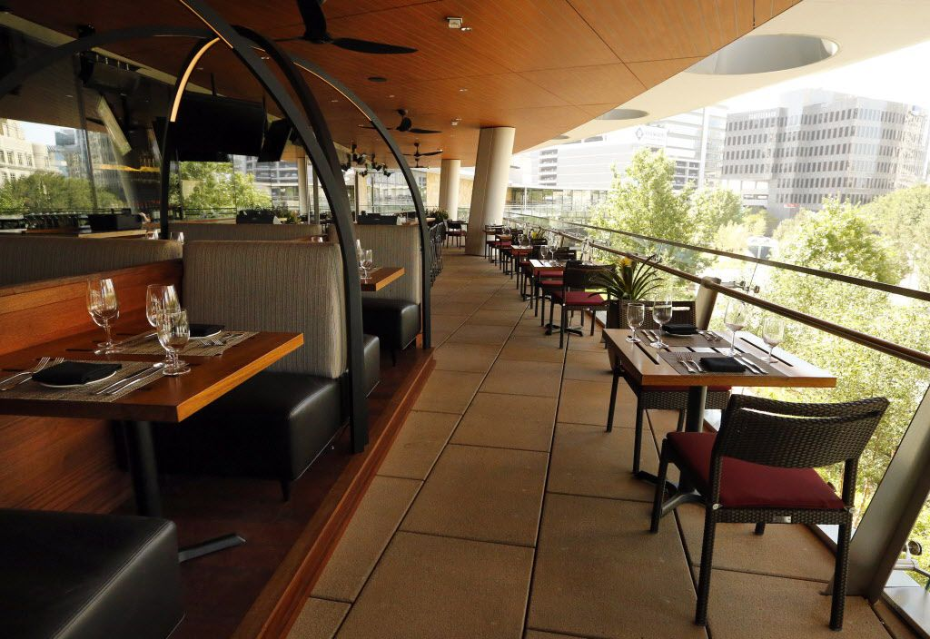 The open air dining area is seen on the upper floor of the new Del Frisco's Double Eagle Steak House in Uptown Dallas, Friday, September 9, 2016. Diners can view the 1-acre-plaza from the this balcony. The original, located on Spring Valley since 1994, has closed and the new one opens Saturday. (Tom Fox/The Dallas Morning News)