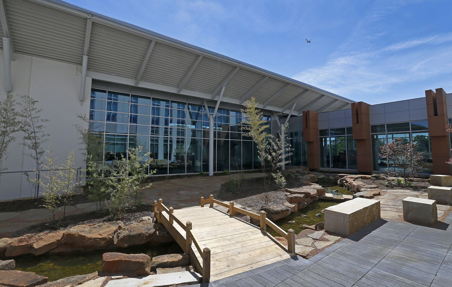 """The buildings feature a """"net zero"""" system for water use, which collects rainwater and uses it for irrigation as well as supplemental fortification of the stream between the Research and Development building and office buildings at the new Kubota Tractor Corp. headquarters in Grapevine."""