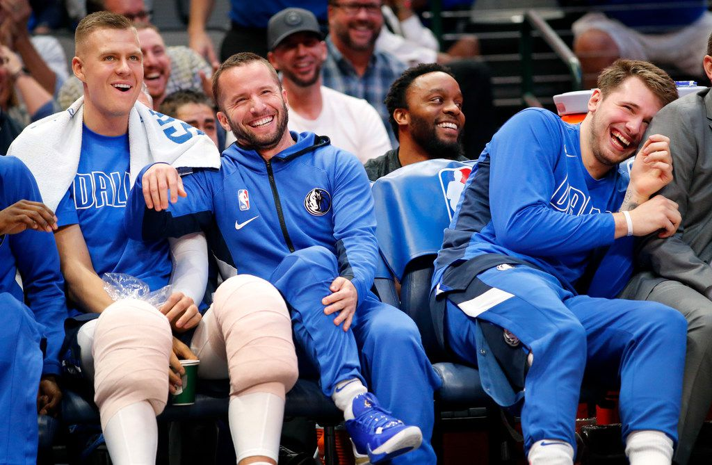 After a continuous chant of J-J, Dallas Mavericks guard J.J. Barea (center) leapt up off the bench as if he was going into the game. Here he laughs with teammates Kristaps Porzingis (left) and Luka Doncic (right) after they were surprised by the fourth quarter move at the American Airlines Center in Dallas, Wednesday, November 20, 2019.)