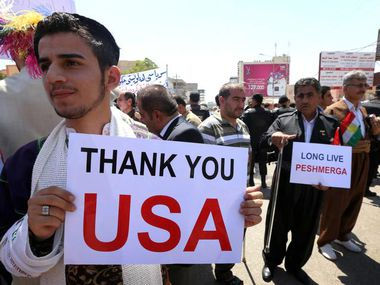 Iraqi Kurds and Iraqi Christians display signs thanking America during a demonstration in front of the U.S. General Consulate in Arbil, the capital of the autonomous Kurdish region of northern Iraq.