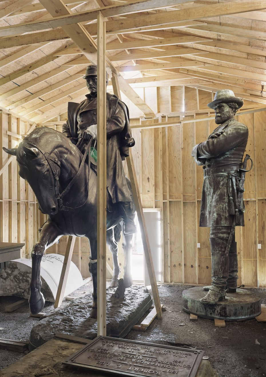 """An-My Lê's 2017 photo """"Fragment VI: General Robert E. Lee and P. G. T. Beauregard Monuments, Homeland Security Storage, New Orleans"""" is part of her """"Silent General"""" series. She began the series after the racially motivated 2015 mass shooting at Emanuel African Methodist Episcopal Church in Charleston, S.C. (© An-My Lê. Courtesy of the artist and Marian Goodman Gallery, New York, Paris and London)"""