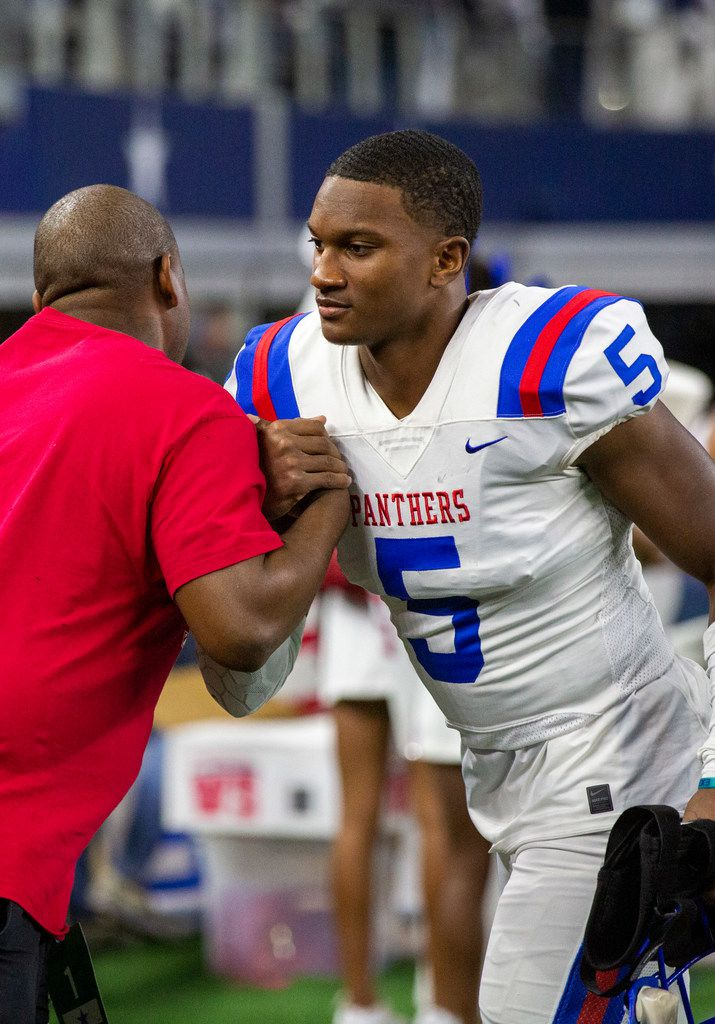 Duncanville defensive back Christopher Thompson Jr. (5) is congratulated after beating Flower Mound 59-13 in the Class 6A Division I area-round high school football playoff game at the AT&T Stadium in Arlington, Texas, on Saturday, November 23, 2019. (Lynda M. Gonzalez/The Dallas Morning News)