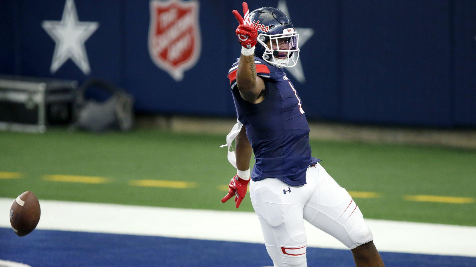 Denton Ryan receiver Ja'Tavion Sanders (1) scores a first quarter touchdown on a long catch and run against Arlington Martin at AT&T Stadium in Arlington, Friday, September 25, 2020.