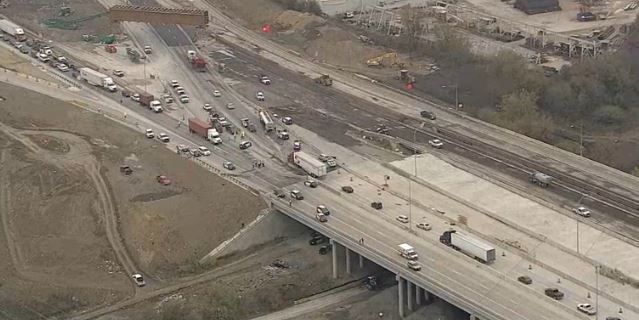 An SUV flew off the highway after an 18-wheeler going north on Interstate 35W struck a concrete median barrier, which moved into the southbound lanes, Tuesday in Fort Worth. (KXAS-TV (NBC5))
