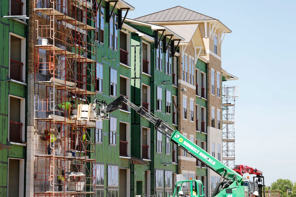 Construction continues on an apartment complex at 3100 Ohio Drive in Frisco on Wednesday, June 21, 2017. (Vernon Bryant/The Dallas Morning News)