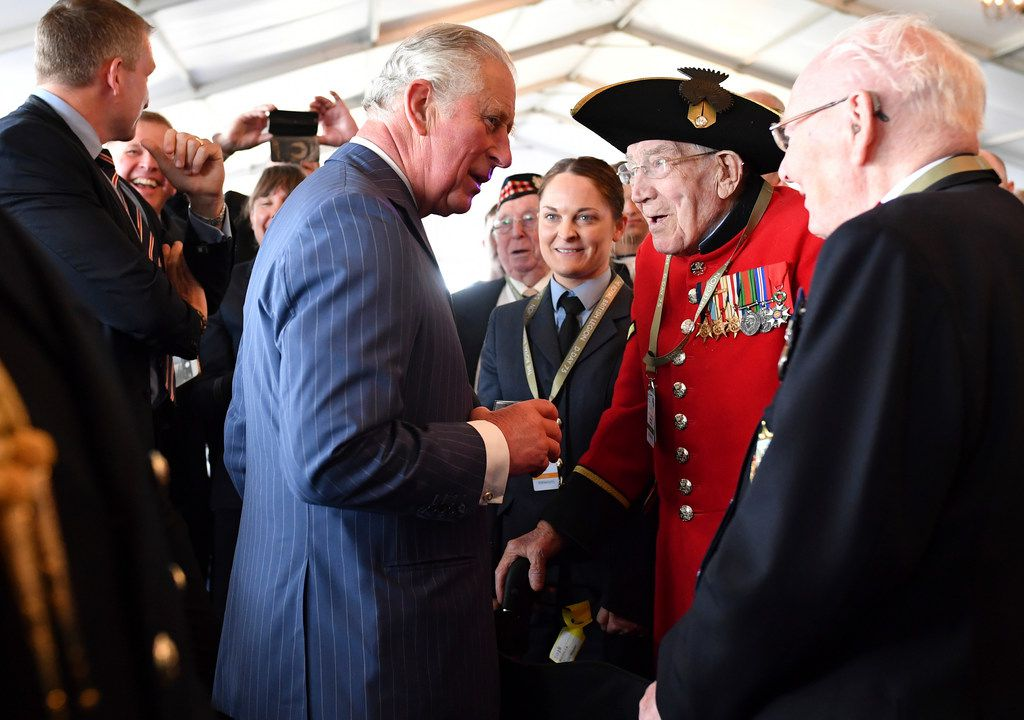 Britain's Prince Charles, second left, meets veterans during a function during the D-Day 75th anniversary commemorations,  in Portsmouth, England, Wednesday June 5, 2019, Commemoration events are marking the 75th Anniversary of the D-Day landings when Allied forces stormed the beaches of Normandy in northern France during World War II.