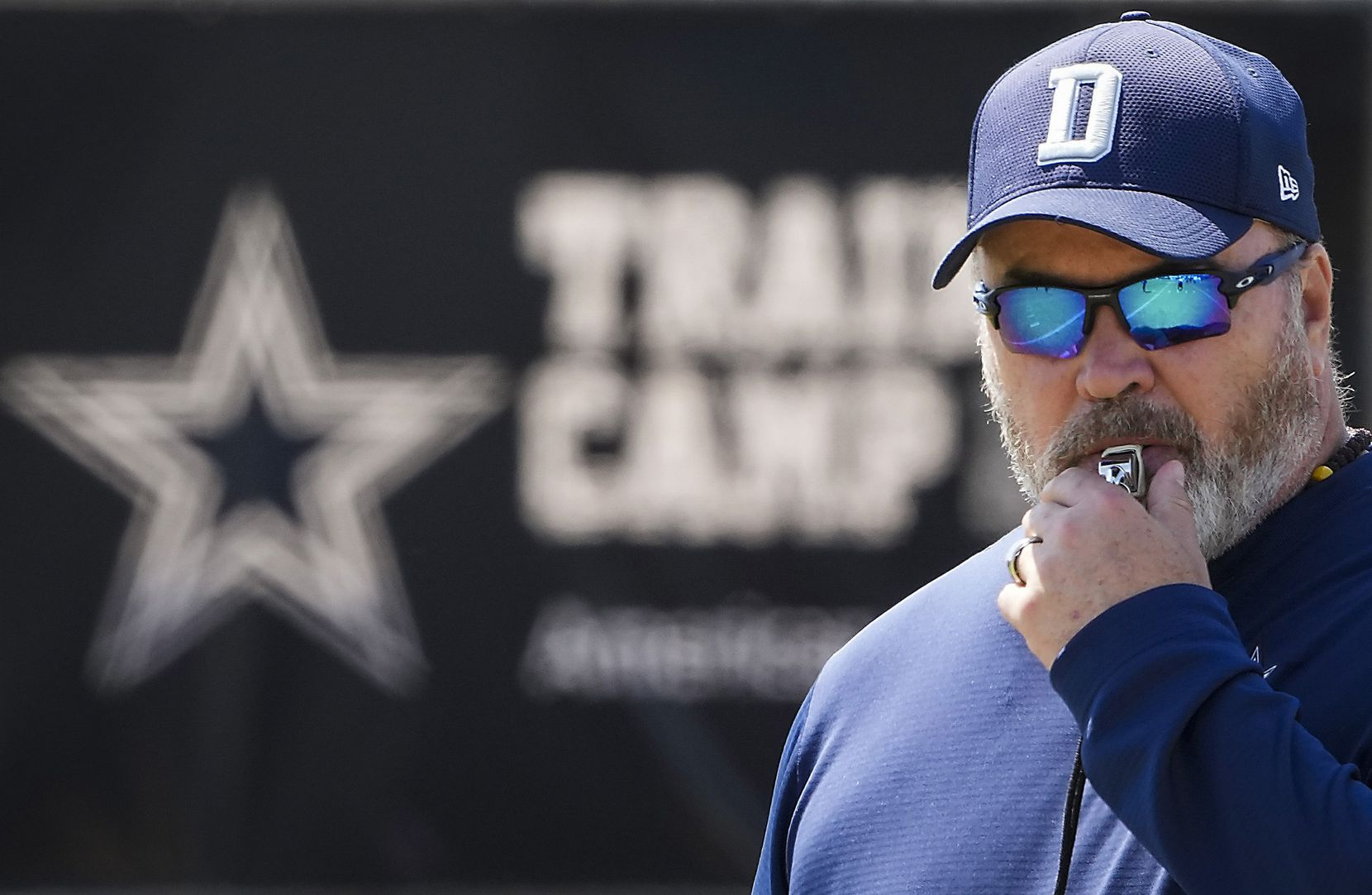 Dallas Cowboys head coach Mike McCarthy blows a whistle during a practice at training camp on Tuesday, Aug. 10, 2021, in Oxnard, Calif.