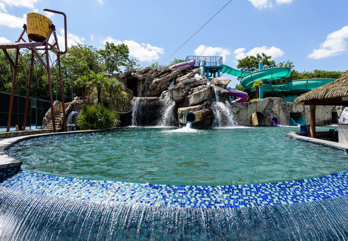 The waterpark has pools and slides.