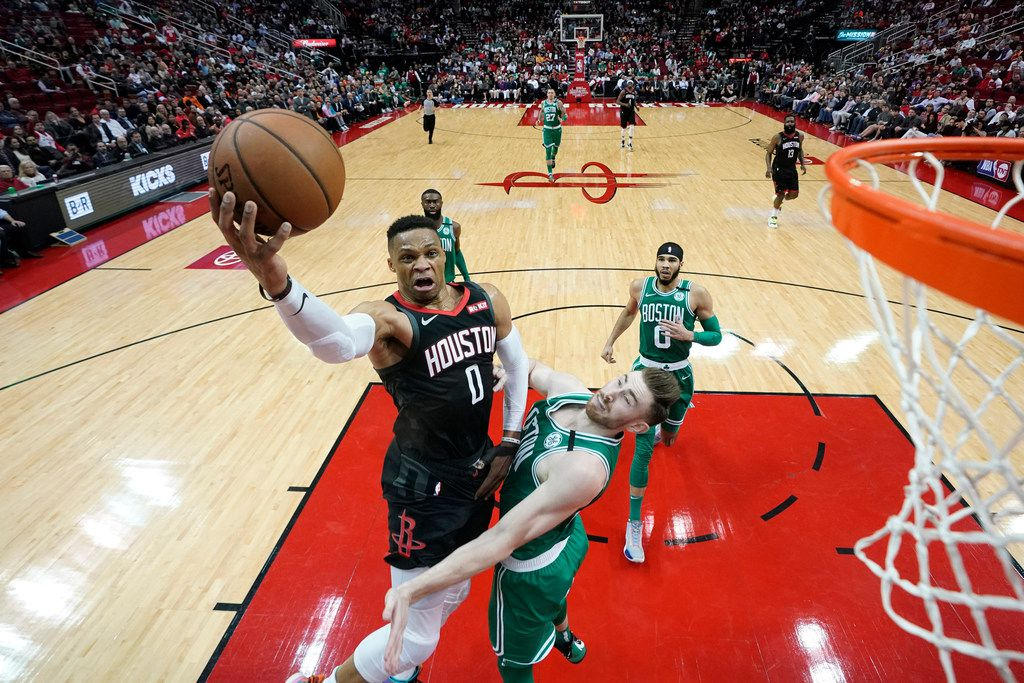 Houston Rockets' Russell Westbrook (0) goes up for a shot as Boston Celtics' Gordon Hayward defends during the second half of an NBA basketball game Tuesday, Feb. 11, 2020, in Houston.