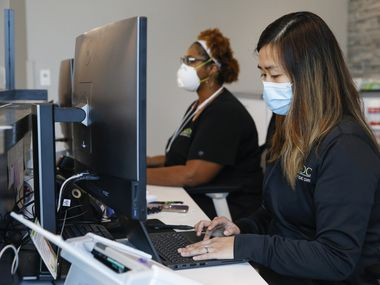 Sherita Mills, radiological technologist, left, and Vanessa Chang, practice manager, work at Direct Orthopedic Care in Frisco. After Gov. Greg Abbott revised the rules on elective surgery, the company is gearing up to welcome back patients who need knee replacements, rotator cuff surgery and similar procedures that had been suspended for the past month.