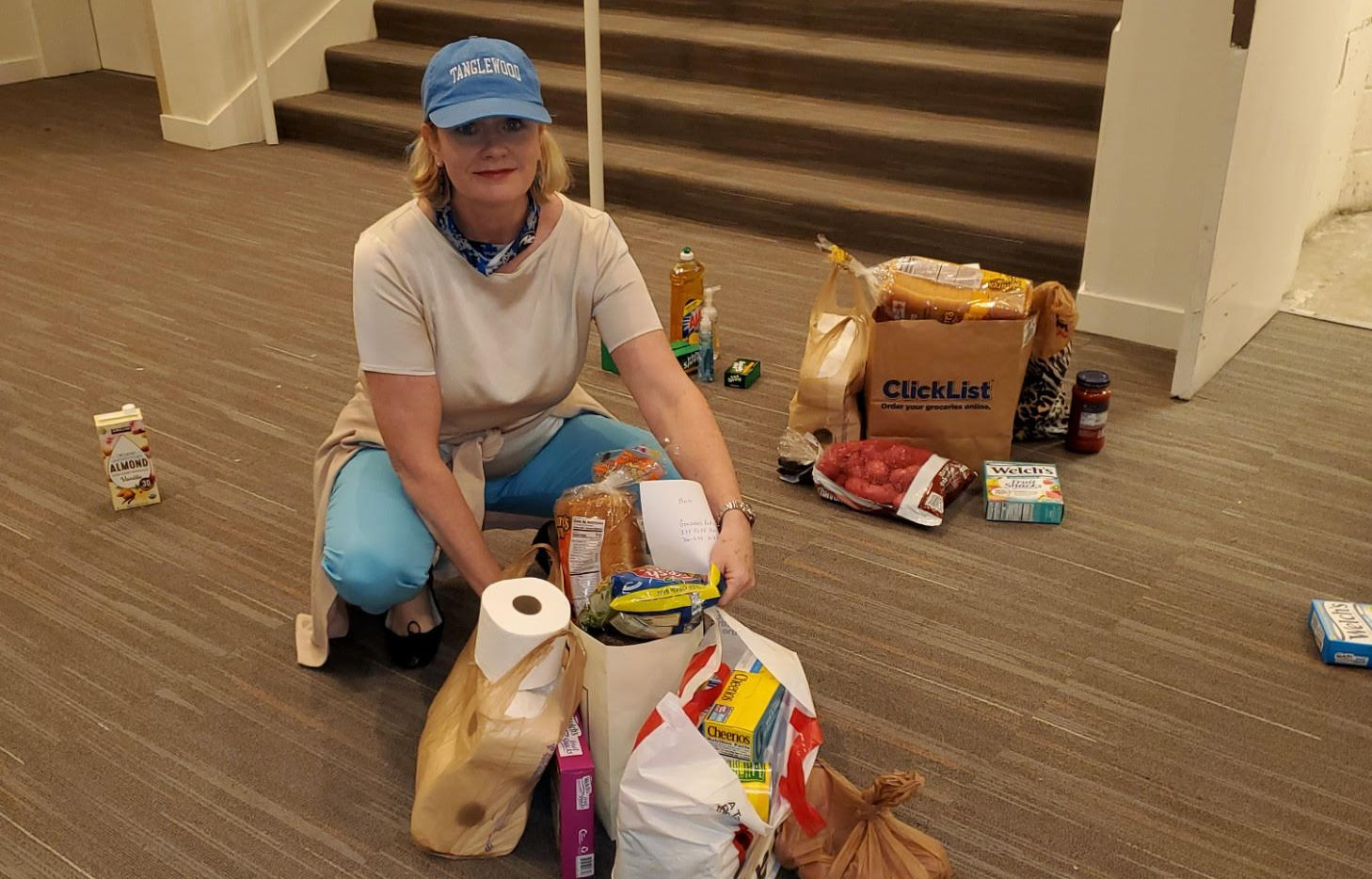 Kim Noltemy, president and chief executive of the Dallas Symphony Orchestra, gathers groceries to deliver to families affiliated with the DSO's Young Strings and Young Musicians programs.