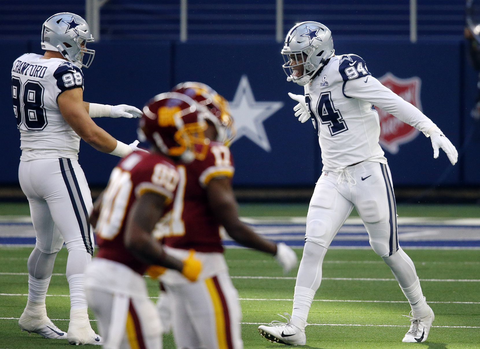 Dallas Cowboys defensive end Randy Gregory (94) celebrates his third down stop against the Washington Football Team during the first quarter at AT&T Stadium in Arlington, Thursday, November 26, 2020. (Tom Fox/The Dallas Morning News)