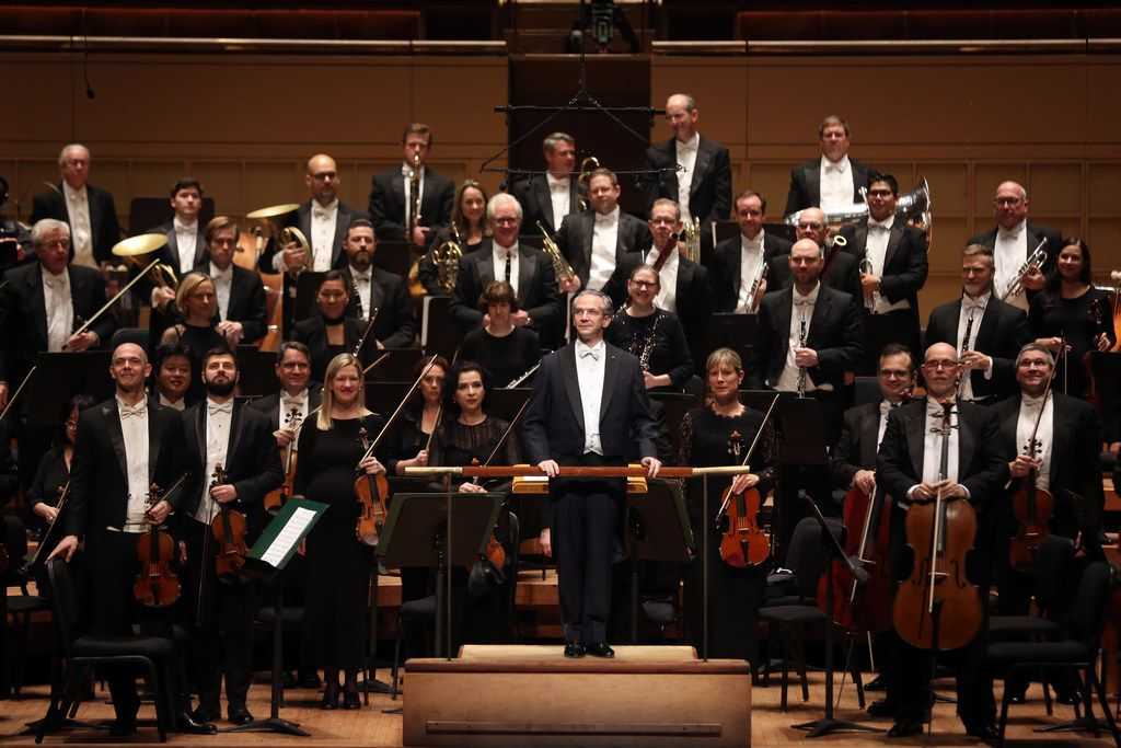 "Dallas Symphony Orchestra music director-designate Fabio Luisi (center) acknowledges the audience before conducting William Grant Still's ""Poem"" at the Meyerson Symphony Center."