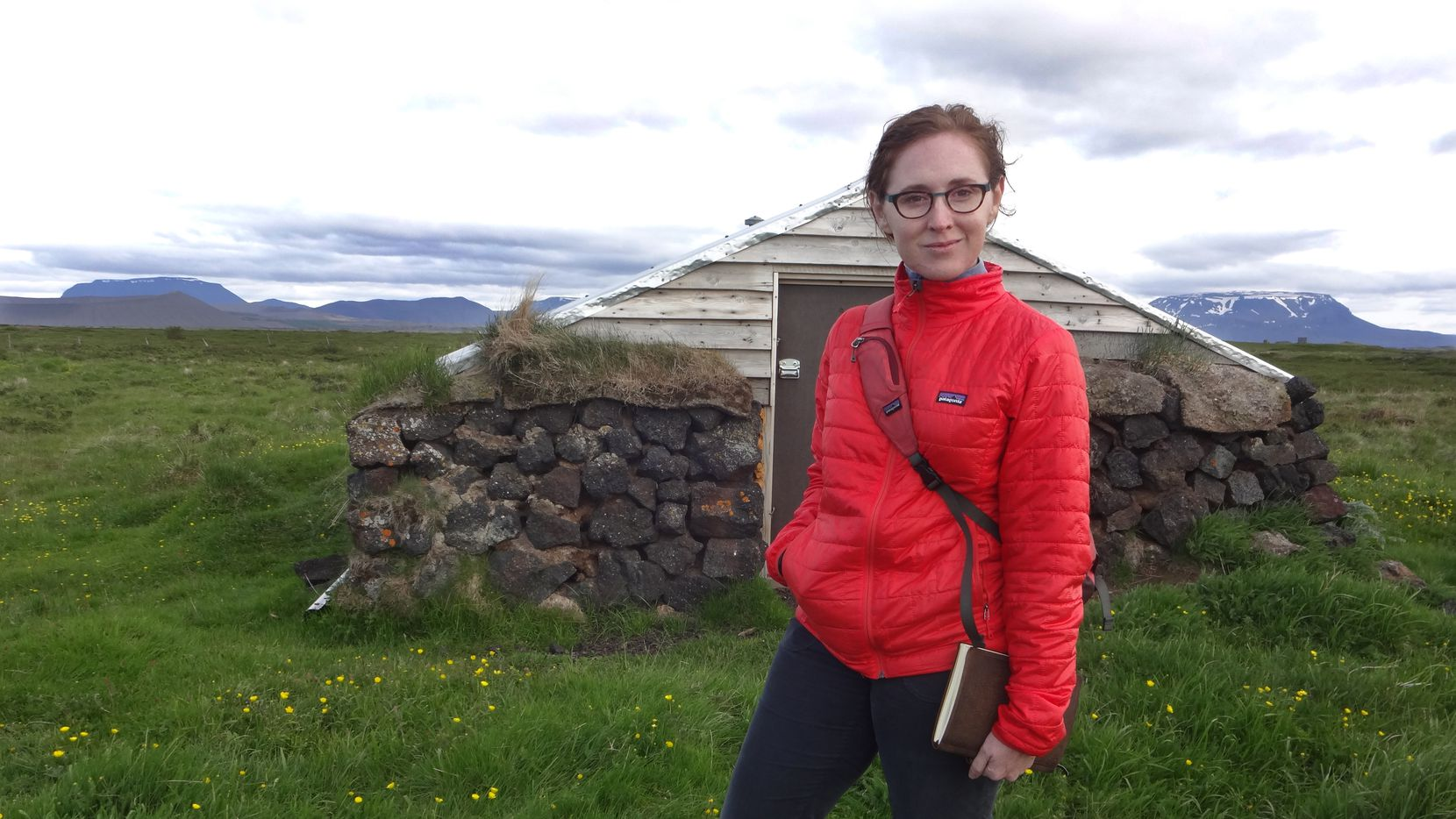 Author Kendra Greene with her notebook, in front of a smoke shed on Ytri-Nesl ndum farm, a stone's throw from the family-run Fuglasafn Sigurgeirs (Sigurgeir's Bird Museum), M vatn, July 5, 2015.