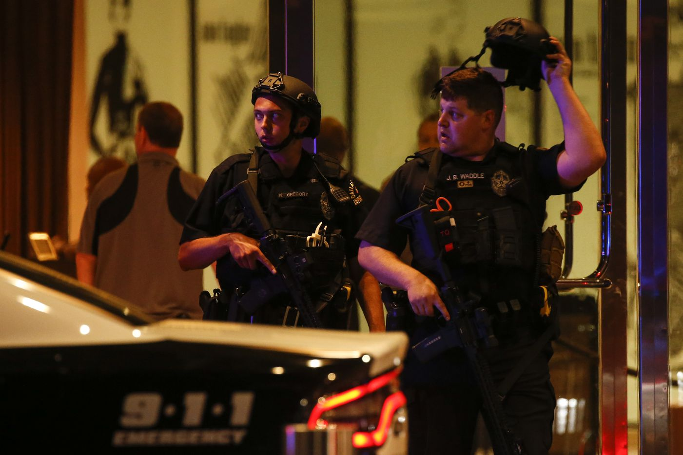 Dallas police return to their cars after responding to the Galleria Mall, where a shooting was reported Tuesday, June 16, 2020 in Dallas.