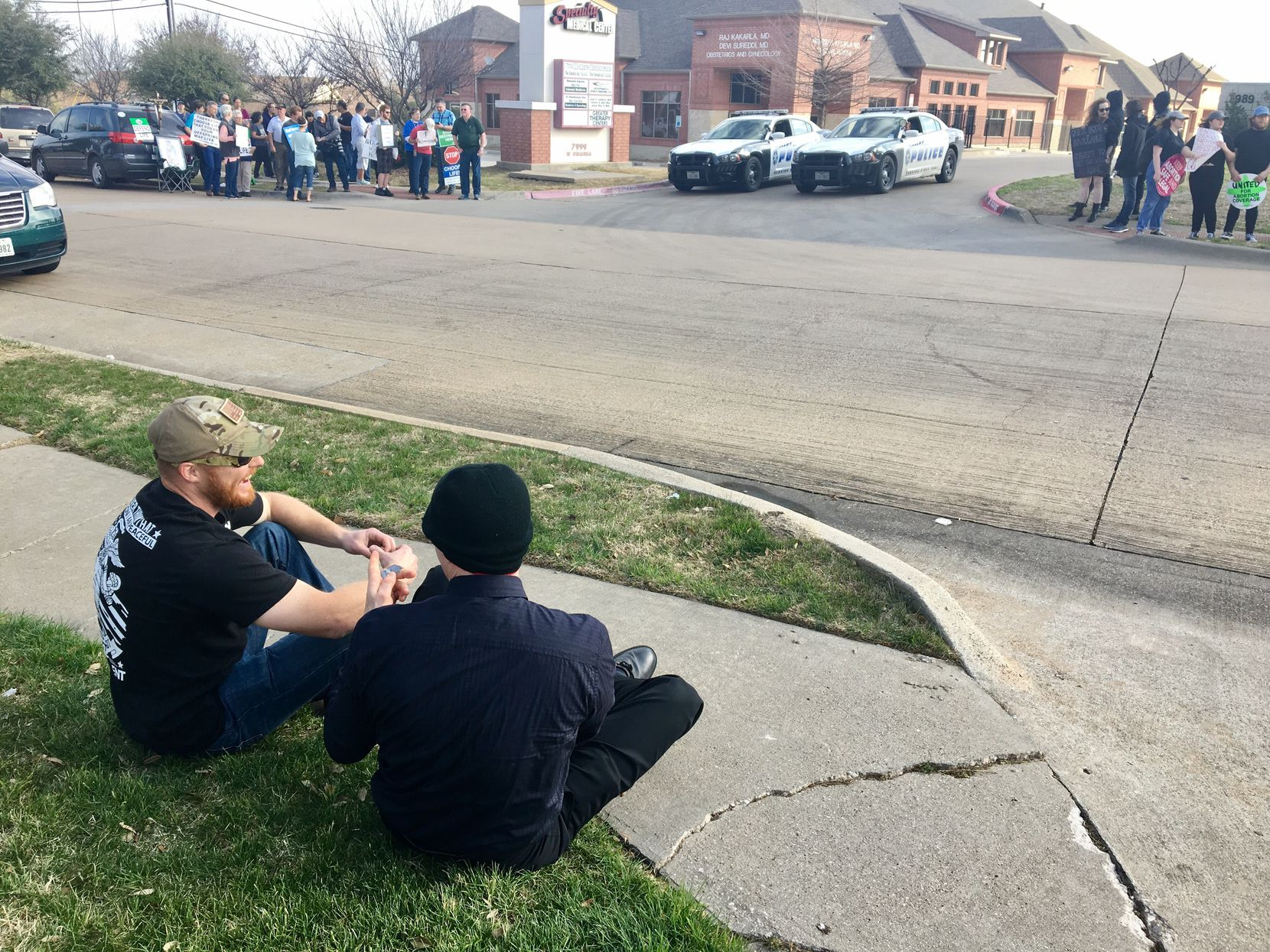 Robert Wetzel (left) and Greg Stevens laughed together Saturday while sharing their opposing views on abortion during protests across from the Planned Parenthood South Dallas Surgical Health Services Center. Wetzel is a youth minister at a Protestant church in Forney and Stevens is a member of the Satanic Temple of Dallas.