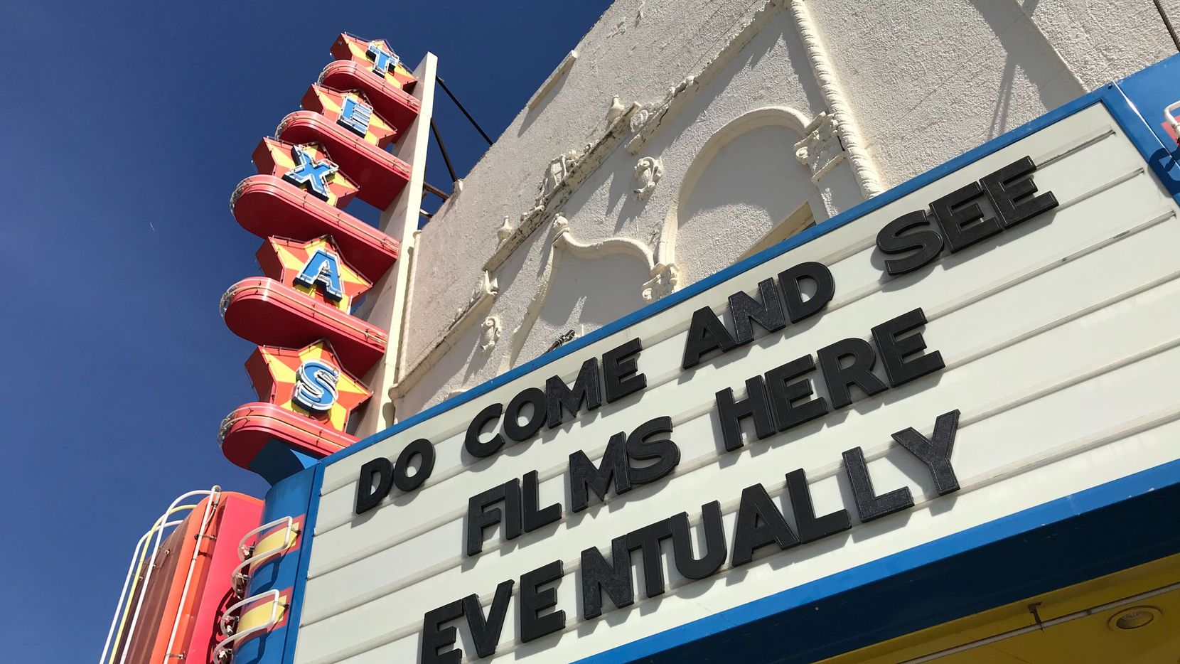 """""""Do come and see films here ... eventually,"""" the Texas Theatre marquee said in May. The theater has been screening drive-in movies for months, and on Oct. 24, it will reopen its doors for two limited-capacity screenings of the original """"A Nightmare on Elm Street."""""""