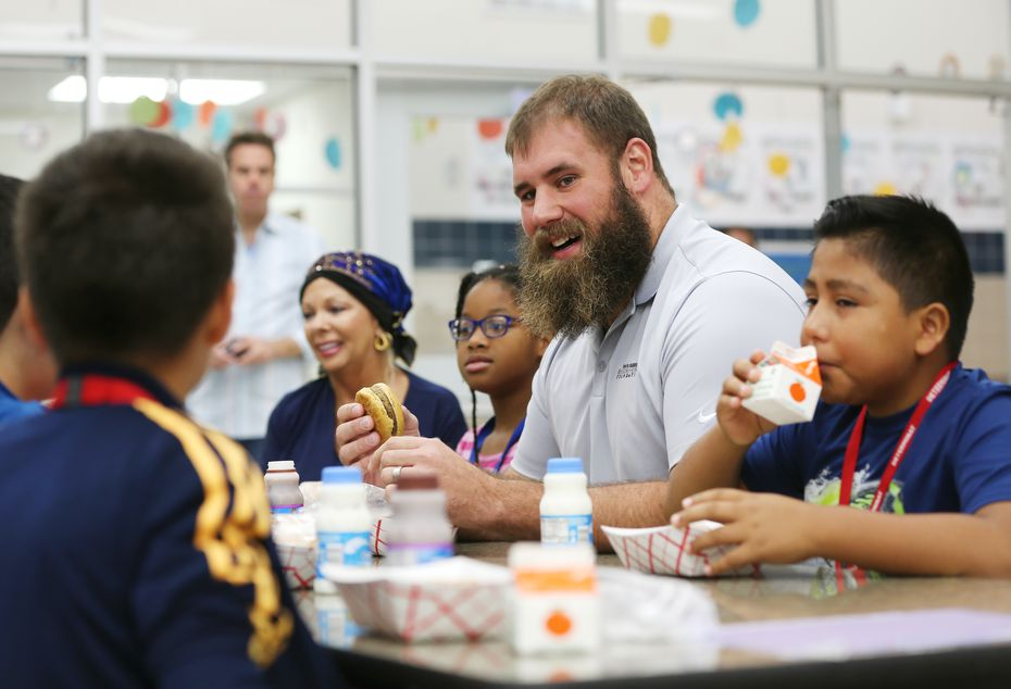FILE - Travis Frederick eats breakfast with fifth-grade students as part of the launching of Travis' Pantry at Dr. Linda Henrie Elementary in Dallas on Tuesday, Oct. 30, 2018. The pantry, presented by Albertsons and Tom Thumb, is part of Travis Frederick's Blocking Out Hunger Foundation.