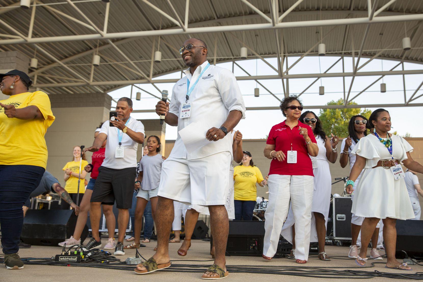Cedar Hill mayor Stephen Mason (center) dances at the Best Southwest Juneteenth Celebration in 2019.