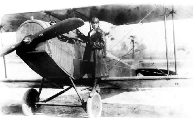 Pioneer aviator Bessie Coleman stands on the wheel of a plane in this 1920s photo. Coleman gave exhibition flights in the United States as well as Europe, earning the name 'Queen Bess,' and tried her best to become famous. But outside the segregated black world in which she lived, few people ever paid attention.
