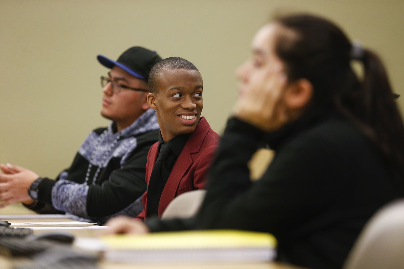 Jaylon Miller looks over his shoulder to his teacher during an computer operating systems class at the University of North Texas at Dallas on Wednesday, Jan. 29, 2020 in Dallas.