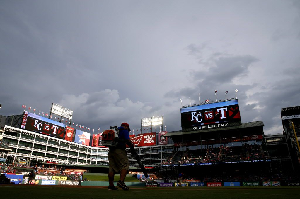 Members of the Rangers ground crew work to dry the field in a rain delay prior to the Kansas City Royals game at Globe Life Park in Arlington, Texas, Thursday, July 28, 2016. (Jae S. Lee/The Dallas Morning News)