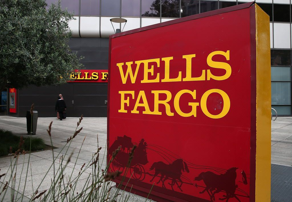 A sign is posted in front of a Wells Fargo bank on October 11, 2013 in Oakland, California. Wells Fargo reported a 13 percent increase in third-quarter profits with a net income of $5.6 billion, or 99 cents a share compared to $4.9 billion, or 88 cents a share one year ago.