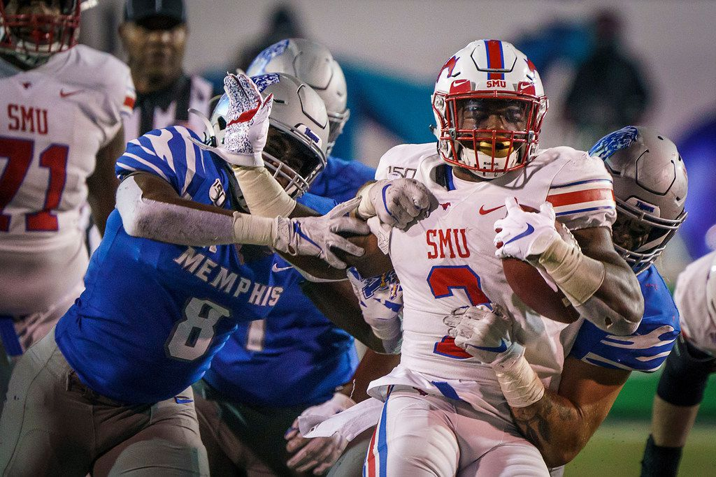 SMU running back Ke'Mon Freeman (2) is brought down by the Memphis defense during the second half of an NCAA football game at Liberty Bowl Memorial Stadium on Saturday, Nov. 2, 2019, in Memphis, Tenn. (Smiley N. Pool/The Dallas Morning News)