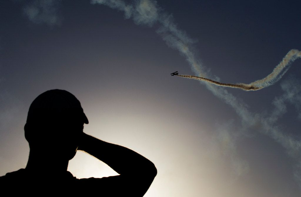 A man watches an air show during Kaboom Town festivities in Addison, Texas on Tuesday, July 3, 2018. (Ashley Landis/The Dallas Morning News)