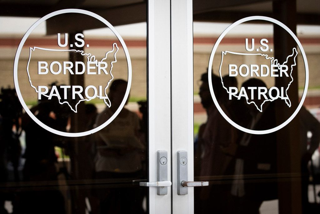 Media are reflected in the doorway as they wait to enter a roundtable discussion at the Weslaco Border Patrol Station on Friday, June 22, 2018, in Weslaco, Texas. Senators John Cornyn and Ted Cruz held the roundtable with representatives of federal agencies, non-profits and local elected officials involved in handling immigrant families. (Smiley N. Pool/The Dallas Morning News)