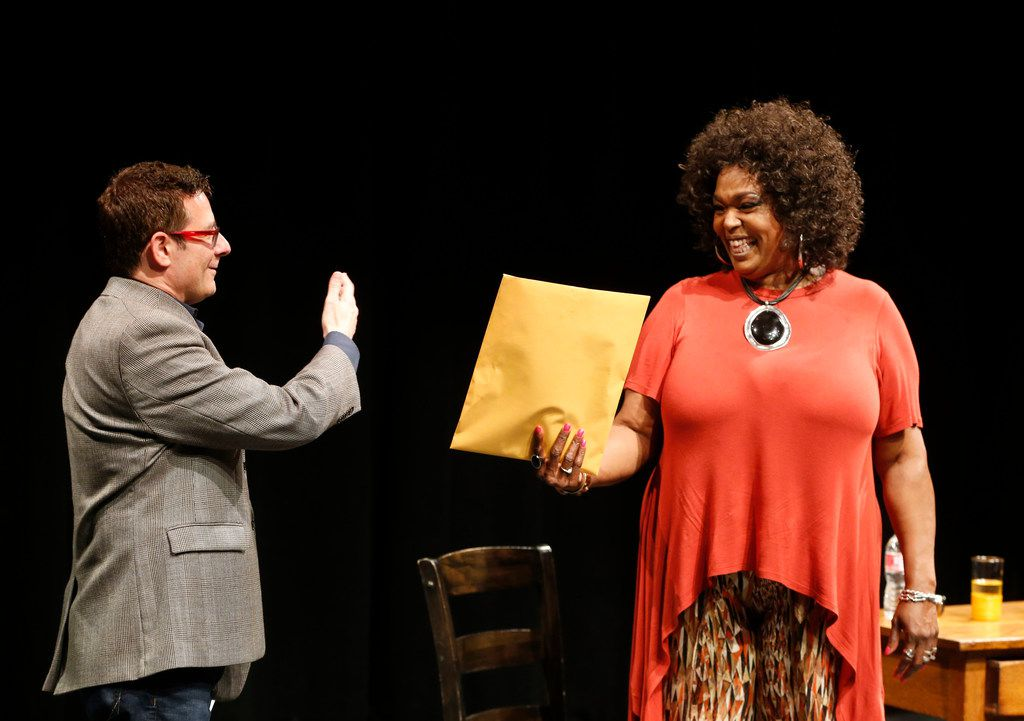 Kevin Moriarty, artisitic director, hands Liz Mikel the script for a production of 'White Rabbit, Red Rabbit' at Wyly Theatre's Studio Theatre in Dallas on May 30. The one actor in the play receives the play when they walk on stage.