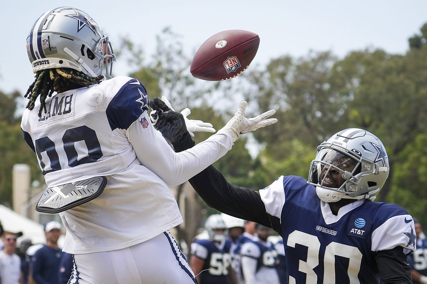 Dallas Cowboys wide receiver CeeDee Lamb (88) catches a touchdown  pass as cornerback Anthony Brown (30) defends during a practice at training camp on Wednesday, Aug. 11, 2021, in Oxnard, Calif.