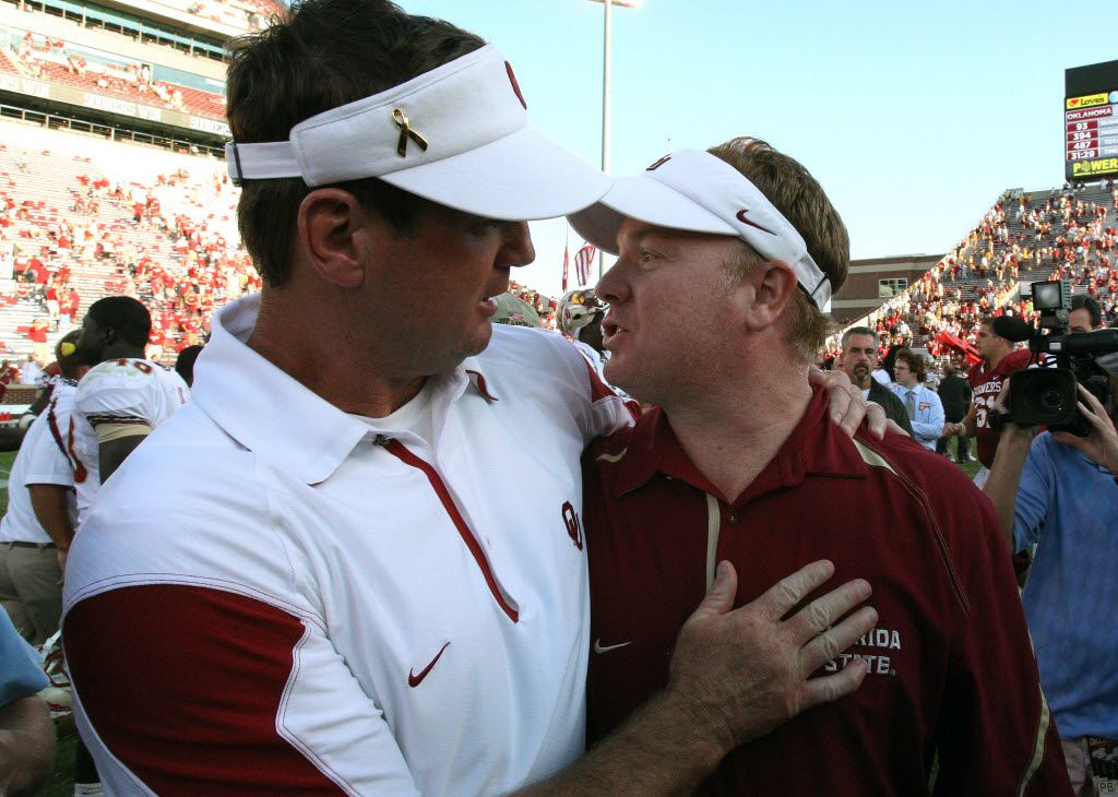 ORG XMIT: USPW-8910950AL Sep 11, 2010; Norman, OK, USA; Florida State Seminoles defensive coordinator Mark Stoops (right) meets after the game with his brother  Oklahoma Sooners head coach Bob Stoops at Memorial Stadium. The Sooners beat the Seminoles 47-17. Mandatory Credit: Matthew Emmons-US PRESSWIRE 10012010xSPORTS