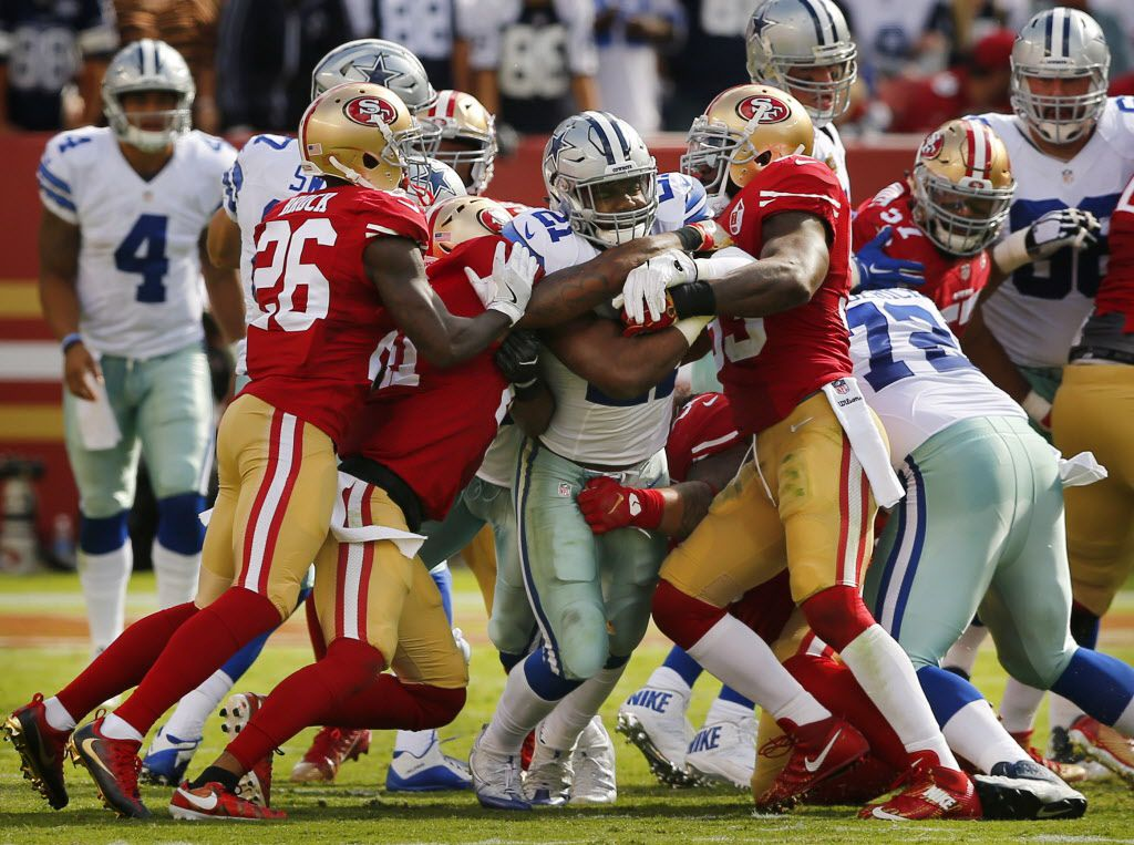 Dallas Cowboys running back Ezekiel Elliott (21) fights for more yards as he is surrounded by San Francisco 49ers defenders in the third quarter at Levi's Stadium in Santa Clara, California, Sunday, October 2, 2016.(Tom Fox/The Dallas Morning News)