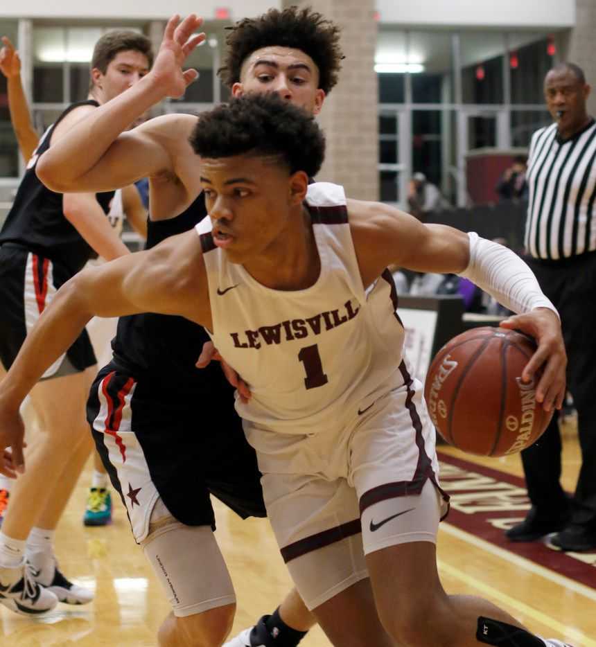 FILE - Lewisville's Keyonte George (1) drives the baseline past Coppell's Brandon Taylor (2) during first-quarter action. The two teams played their District 6-6A game at Lewisville High School in Lewisville on Jan. 28, 2020.