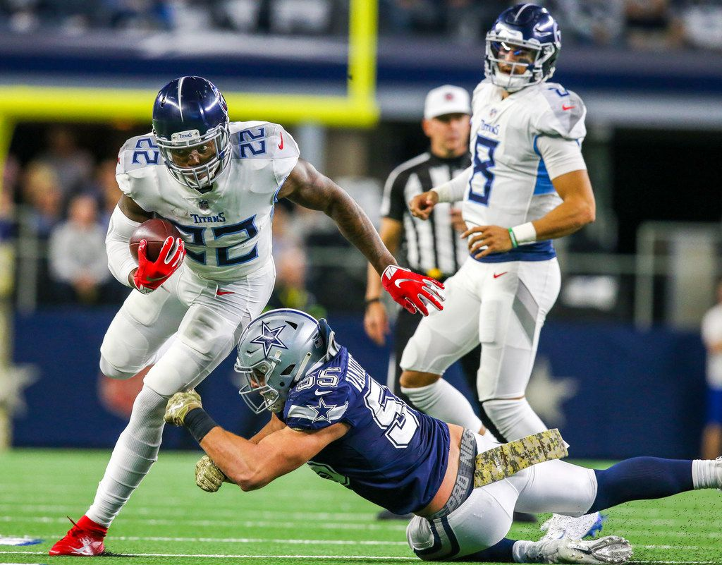 Tennessee Titans running back Derrick Henry (22) carries the ball past Dallas Cowboys outside linebacker Leighton Vander Esch (55) during the second half of an NFL game between Dallas Cowboys and Tennessee Titans at AT&T Stadium in Arlington, Texas on Monday, November 5, 2018. (Shaban Athuman/The Dallas Morning News)