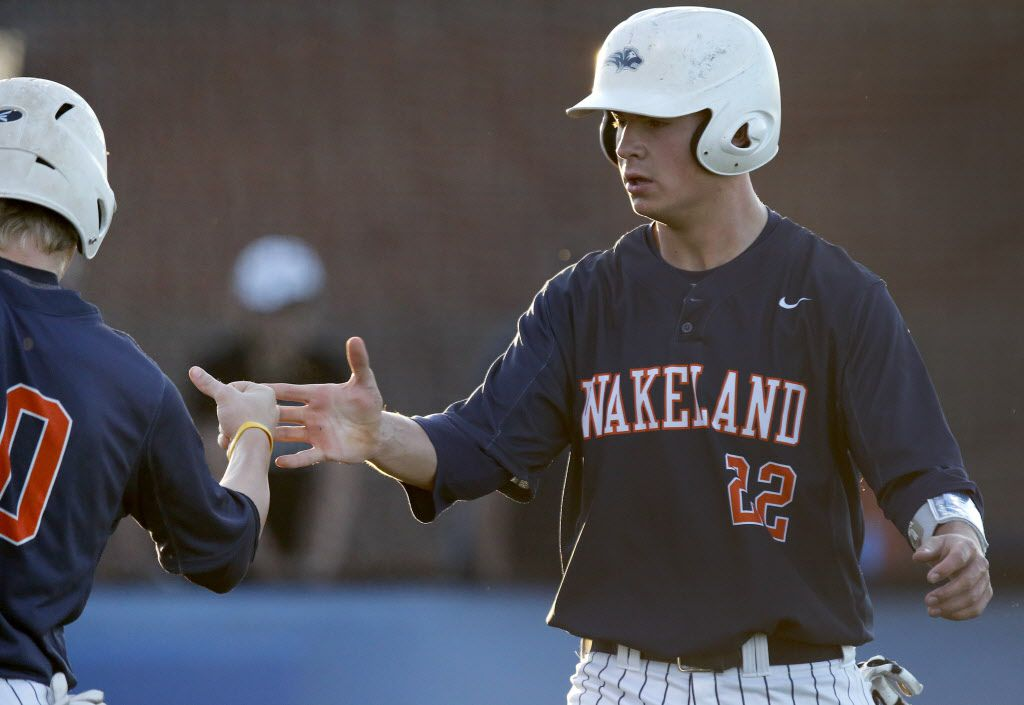 Wakeland High School first baseman Jared Martin (22) is congratulated after scoring a run in the first inning as Frisco Wakeland High School hosted Frisco High School at Smothermon Field in Frisco on Wednesday night, April 27, 2016. (Stewart F. House/Special contributor)