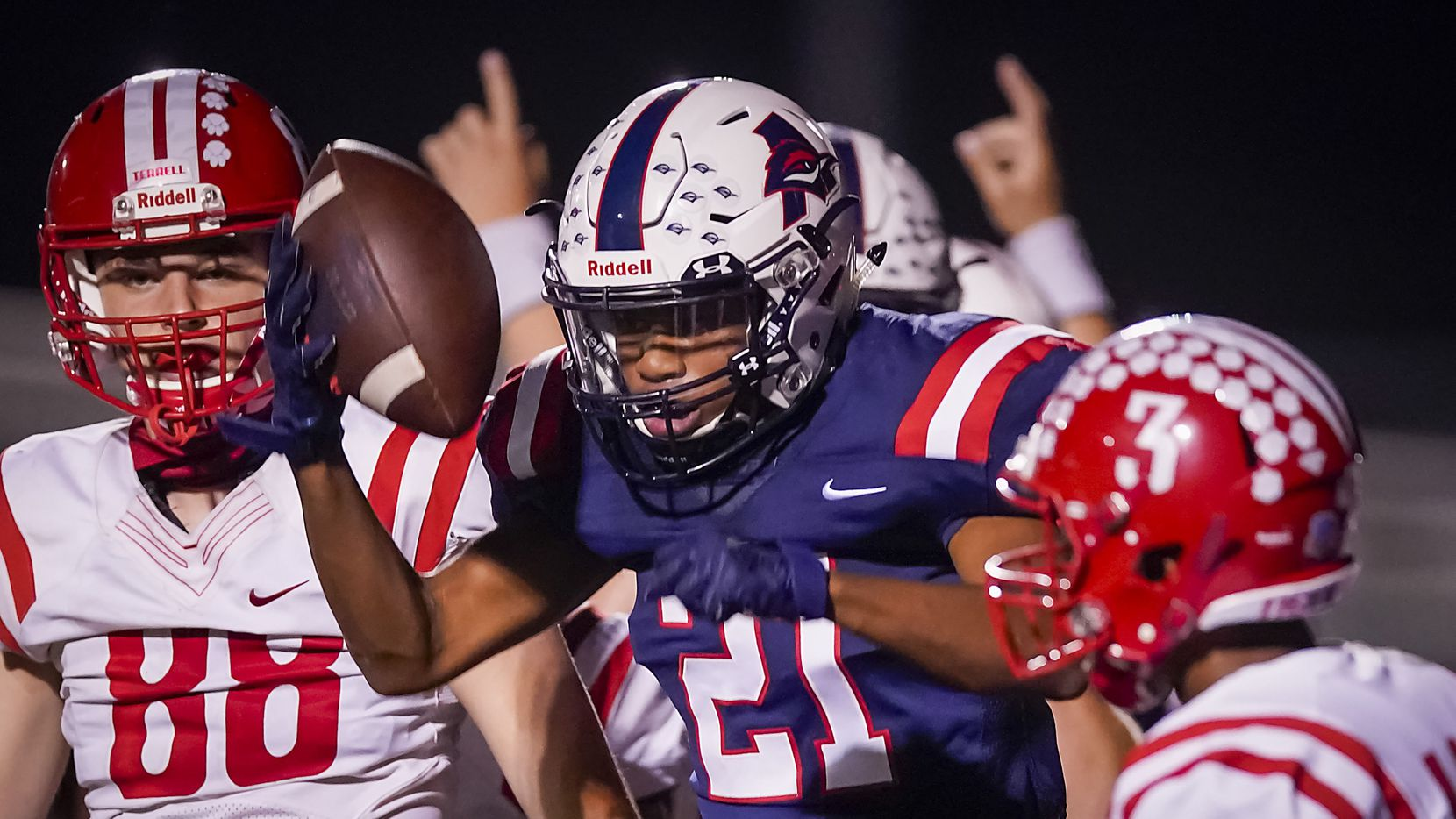Aubrey running back  Braylon Colgrove (21) celebrates after rushing for a touchdown during the first half of a high school football game against Terrell on Friday, Sept. 18, 2020, in Aubrey, Texas.