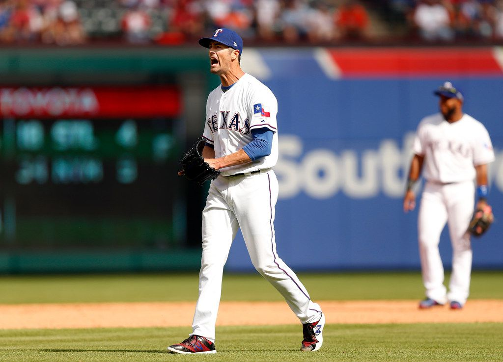 Texas Rangers starting pitcher Cole Hamels (35) reacts after giving up a single to Houston Astros first baseman Marwin Gonzalez (9) in the sixth inning of their Opening Day game at Globe Life Park in Arlington, Texas, Thursday, March 29, 2018. The Astros defeated the Rangers, 4-1. Hamels took the loss. (Tom Fox/The Dallas Morning News)
