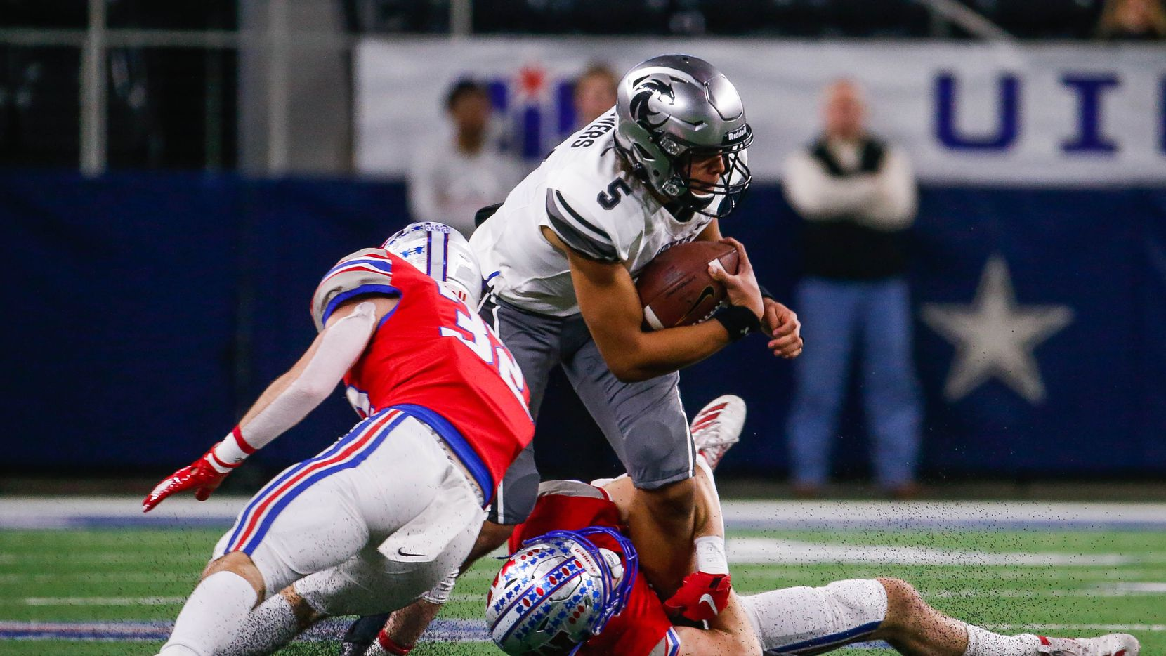 Denton Guyer's quarterback Eli Stowers (5) gets taken down by Austin Westlake's defense in the first quarter of a Class 6A Division II state championship game at the AT&T Stadium in Arlington, on Saturday, December 21, 2019.