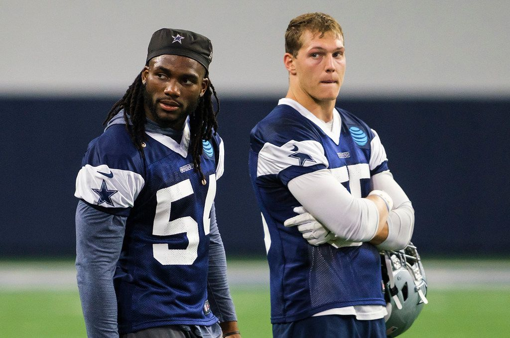 Dallas Cowboys linebackers Jaylon Smith (54) and Leighton Vander Esch (55) watch the second unit work during a team OTA practice at The Star on Wednesday, June 5, 2019, in Frisco. (Smiley N. Pool/The Dallas Morning News)