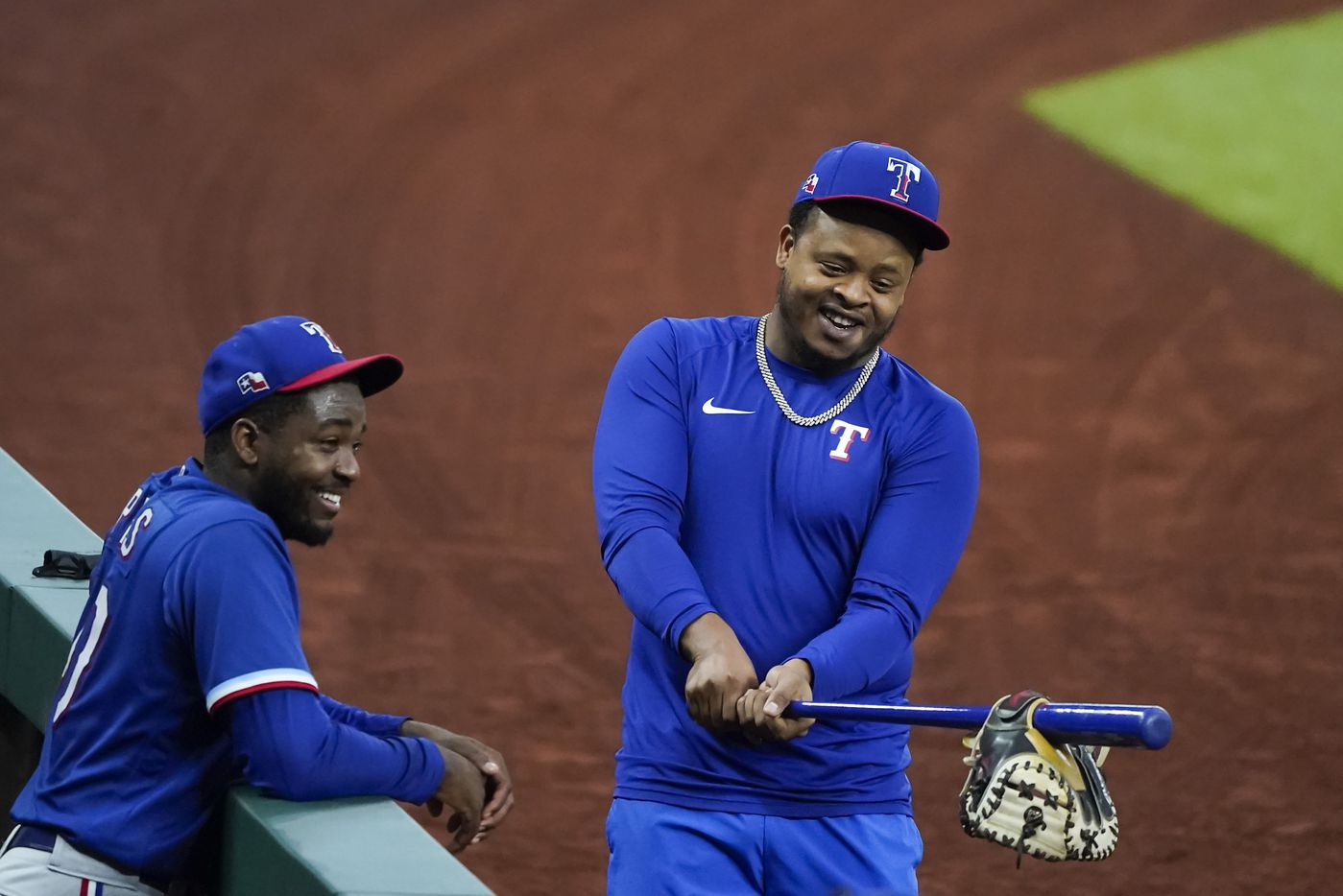 Texas Rangers pitcher Alex Speas (left) laughs with teammate Edinson Vólquez  between innings during a game between players at the team's alternate training site at Globe Life Field on Saturday, Sept. 19, 2020.