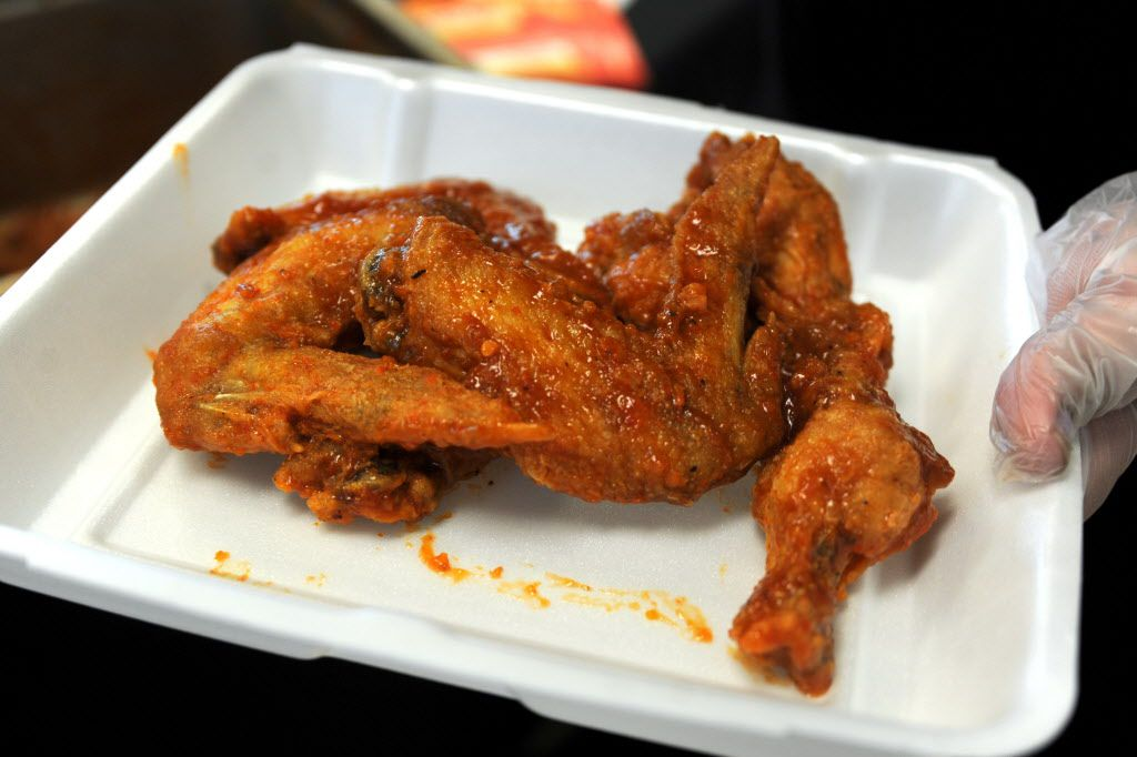 Buffalo Hot +4 wings by Wing Town are prepared at the Taste of Irving Fiery Heat Challenge in Irving, TX on May 16, 2015.