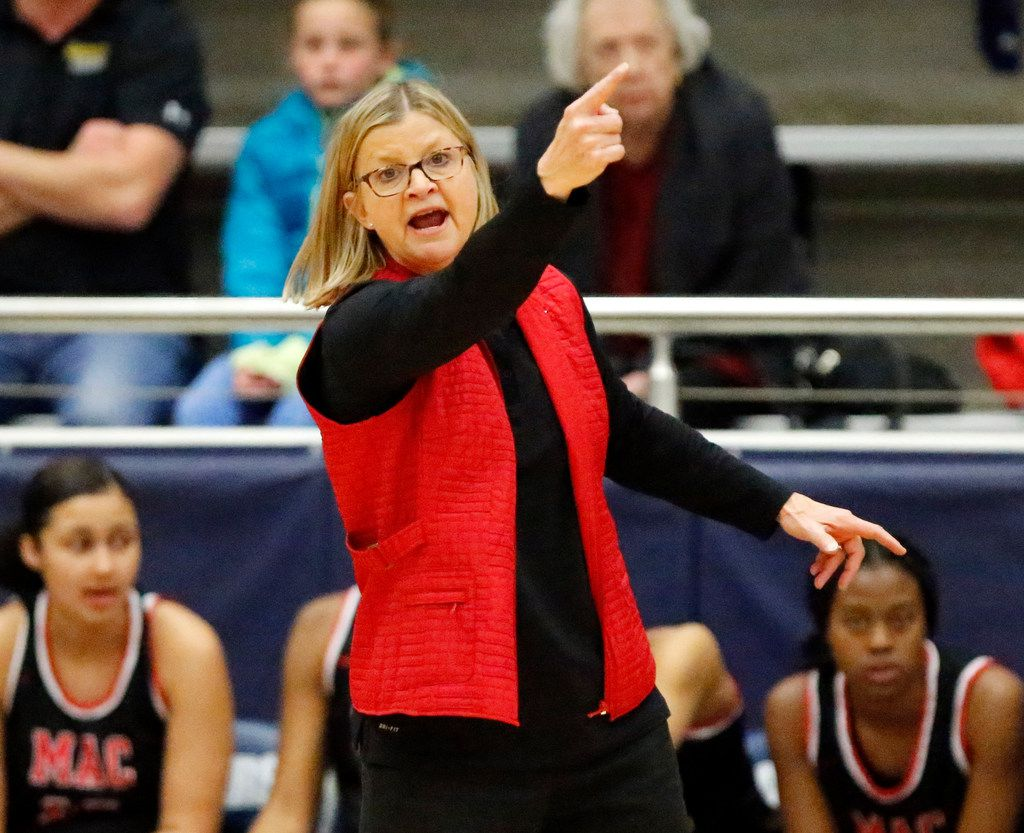 Irving MacArthur's Suzie Oelschlegel gives instruction to her team during a game against Flower Mound on Feb. 11, 2020. (Stewart F. House/Special Contributor)
