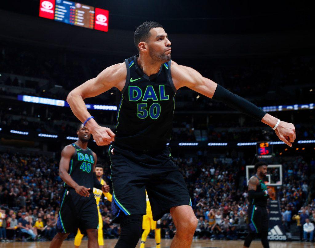 Dallas Mavericks center Salah Mejri reacts after drawing a foul by Denver Nuggets center Nikola Jokic late in the second half of an NBA basketball game Saturday, Jan. 27, 2018, in Denver. The Nuggets won 91-89. (AP Photo/David Zalubowski)