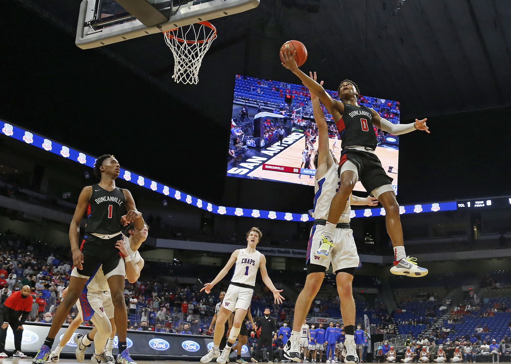 Duncanville Zhuric Phelps #0 drives for two late in fourth quarter. UIL boys Class 6A basketball state championship game between Duncanville and Austin Westlake on Saturday, March 13, 2021 at the Alamodome.