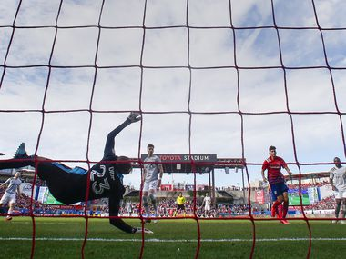 FC Dallas forward Zdenek Ondrasek (13) scores on Montreal Impact goalkeeper Clement Diop (23) during an MLS matchup between FC Dallas and Montreal Impact on Saturday, March 7, 2020 at Toyota Stadium in Frisco, Texas.