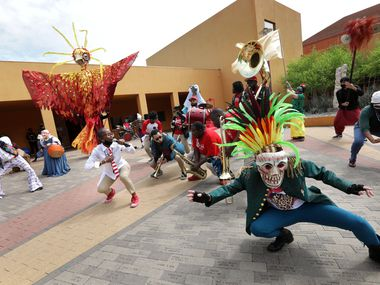 """More than a dozen local actors performed in """"¡Soltar!"""" at the Latino Cultural Center. Organized by Cara Mia Theatre and Teatro Dallas, the spring celebration started half a mile away at Exall Park with the traffic-stopping participants parading down Live Oak Street in Old East Dallas."""