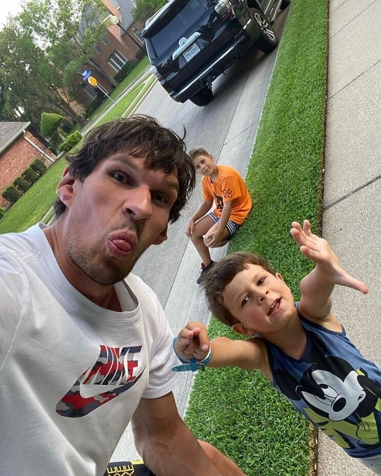 Mavs center Boban Marjanovic takes a selfie with his children, 9-year-old Vuk and 4-year-old Petar.